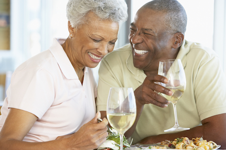 Older couple enjoy a meal together with no issues eating because of partial dentures from Dentures Alaska in Anchorage, AK.